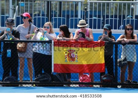 MELBOURNE, AUSTRALIA - JANUARY 26, 2016: Spanish tennis fans during Australian Open 2016 at Australian tennis center in Melbourne Park - stock photo