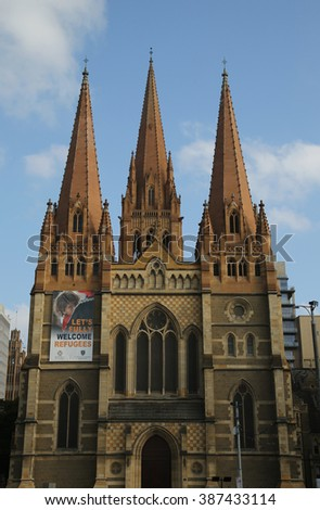 MELBOURNE, AUSTRALIA - JANUARY 25, 2016: St. Paul's Cathedral in Downtown Melbourne. The cathedral was built in stages and is one of the City of Melbourne's major landmarks - stock photo