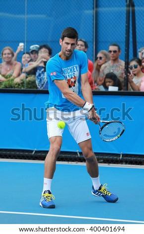 MELBOURNE, AUSTRALIA - JANUARY 27, 2016: Ten times Grand Slam champion Novak Djokovic of Serbia practices for Australian Open 2016 at Australian tennis center in Melbourne Park - stock photo
