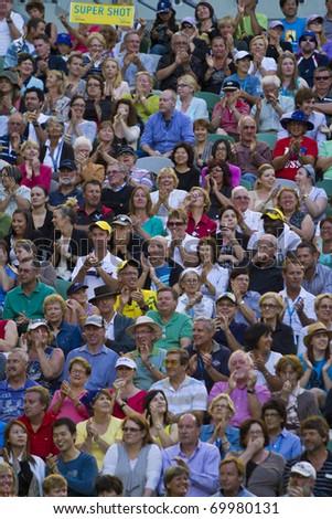 MELBOURNE, AUSTRALIA - JANUARY 26: The crowd watches David Ferrer(ESP)[7] defeat Rafael Nadal(ESP)[1] at the Australian Open on January 26, 2011 in Melbourne, Australia - stock photo