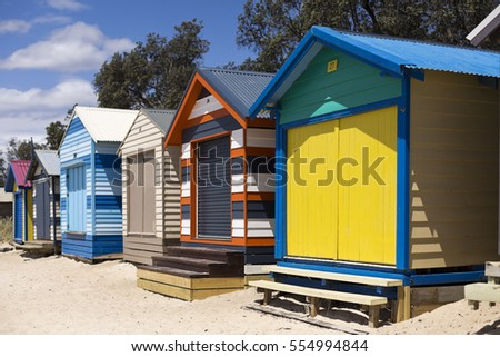 MELBOURNE, AUSTRALIA â?? January 11, 2017: The rainbow coloured bathing boxes are a symbol of summer and a tourist attraction of the Mornington Peninsula, south of Melbourne, Australia