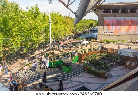 Melbourne, Australia - January 25, 2014: Tram Bar cafe in the Arts Centre forecourt.  The National Gallery of Victoria (NGV) is in the background.