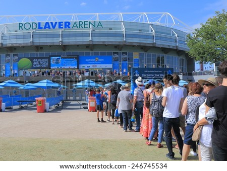 MELBOURNE AUSTRALIA - JANUARY 23, 2015: Unidentified people queue at Australian Open tennis entrance. Australian Open is a major tennis tournament held annually in Melbourne.  - stock photo