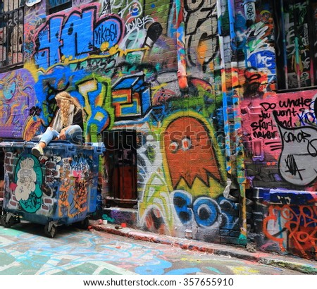 MELBOURNE AUSTRALIA - JANUARY 2, 2016: Unidentified people visit Hosier lane. Melbourne's graffiti management plan recognises the importance of street art.