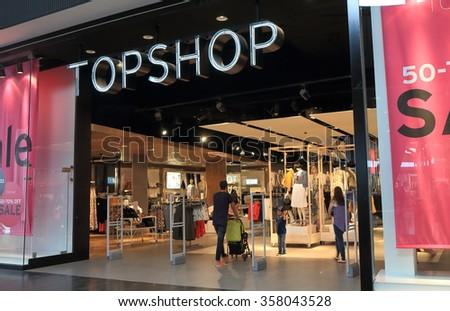 MELBOURNE AUSTRALIA - JANUARY 1, 2016: Unidentified people visit Topshop store. Top shop is a British fashion retailer with more than 500 shops worldwide.  - stock photo