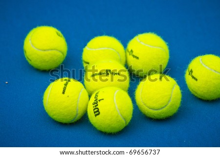 MELBOURNE, AUSTRALIA - JANUARY 22:  Used game balls on the center court at the Rod Laver Arena at the Australian Open, January 22, 2011 in Melbourne, Australia - stock photo