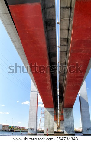 MELBOURNE, AUSTRALIA - JANUARY 16, 2015: View from below Bolte Bridge crossing the Yarra river in Melbourne, Victoria, Australien, on a sunny summer day.
