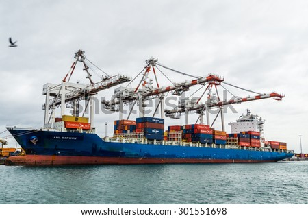 Melbourne, Australia - July 25, 2015: container ship ANL Barwon being unloaded at Swanston Dock in the Port of Melbourne. The Port of Melbourne is Australia's busiest container port.