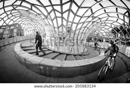 MELBOURNE, AUSTRALIA - July 3 2014:  Webb Bridge is an award winning bridge crossing the Yarra River at Docklands Park - stock photo