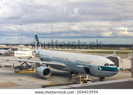 MELBOURNE, AUSTRALIA- JUNE 5, 2014: Preparing of a Qantas airplane for flight in Terminal 2 at Melbourne Tullamarine Airport. This is the second busiest airport in Australia.