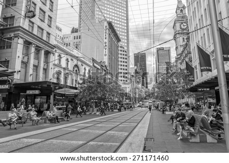 MELBOURNE, AUSTRALIA - MARCH 16, 2015: Black and white scene of the Burke street life on autumn afternoon.