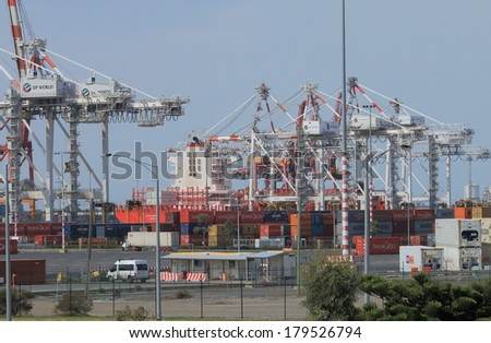 MELBOURNE AUSTRALIA - March 1,2014: Large cargo ship loads containers at Port of Melbourne dock - The port is expected to reach capacity by 2015 due to surging container traffic.