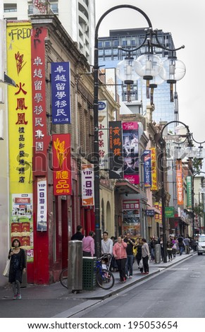 Melbourne, Australia-March 18th 2013: Bustling Chinatown. Established in 1854 Melbourne's Chinatown is the longest continuous Chinese settlement in the western world. - stock photo