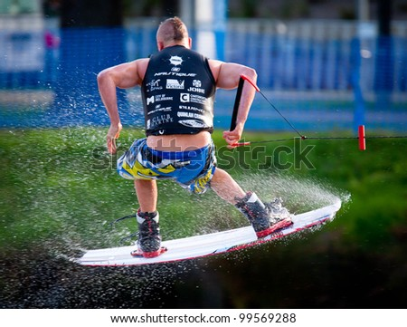 MELBOURNE, AUSTRALIA - MARCH 12: Unidentified competitor in the wakeboarding event at the Moomba Masters on March 12, 2012 in Melbourne, Australia - stock photo