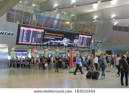 MELBOURNE AUSTRALIA - MARCH 14, 2014: Unidentified people queue at Melbourne Airport departure gate - Melbourne Airport is the primary airport serving Melbourne and hub for Qantas airlines  - stock photo