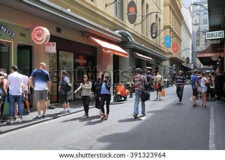 MELBOURNE AUSTRALIA - MARCH 13, 2016: Unidentified people walk Melbourne café street in downtown Melbourne.  - stock photo