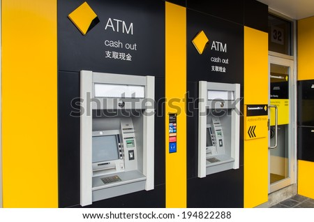 MELBOURNE, AUSTRALIA - May 25, 2014: Automated teller machines of the Commonwealth Bank of Australia, Australia's largest and the world's 10th largest bank by market capitalization (US$115 billion). - stock photo