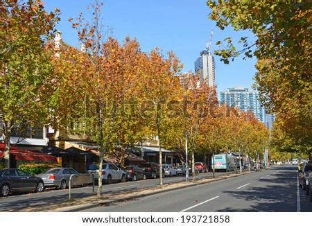 Melbourne, Australia - May 14, 2014: Lygon Street in Autumn - home to many of Melbourne's famous restaurants, cafes and bars. - stock photo