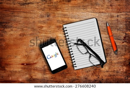 Melbourne,Australia-May 7,2015: Photo of open Google page on smartphone on the table. - stock photo