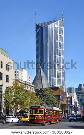 Melbourne, Australia - May 14, 2014: Vintage red tram in La Trobe street. In the background is the central tower and ME Bank Building