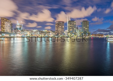 Melbourne, Australia. Night skyline from New Quay Promenade. City reflections.