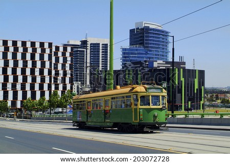 MELBOURNE, AUSTRALIA - NOVEMBER 09: Public tram and modern office buildings on Victoria harbor in the capital city of Victoria, on November 09, 2006 in Melbourne, Australia