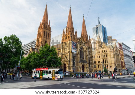 Melbourne, Australia - November 3, 2015: Z-class tram built by Comeng travelling along Swanston Street in front of St Paul's Anglican Cathedral, across the road from Flinders Street Station. - stock photo