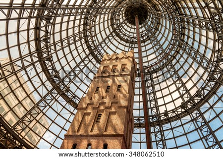 MELBOURNE, AUSTRALIA - OCT 12: Interior of Melbourne Central Shopping Centre on October 12, 2015 in Melbourne. It's a large shopping centre, office, and public transport hub in Melbourne, Australia. - stock photo