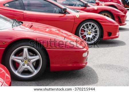 Melbourne, Australia - Oct 23, 2015: Row of red Ferrari on public display in a car show in Melbourne - stock photo