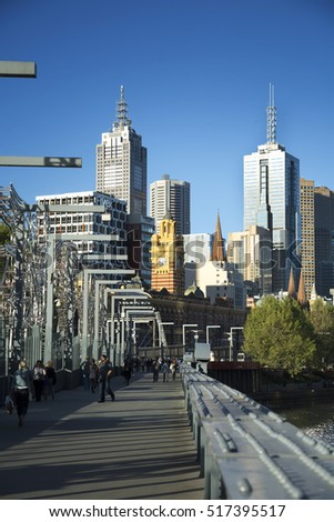 MELBOURNE, AUSTRALIA - OCTOBER 14, 2016: Footbridge in Downtown Melbourne over the Yarra river in Australia with buildings in background.  Melbourne have many footbridges.