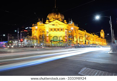 MELBOURNE, AUSTRALIA - OCTOBER 24: Night scene of Flinders street station on October 24, 2015. Its the busiest station on Melbourne's metropolitan network and one of the iconic landmark in Melbourne. - stock photo