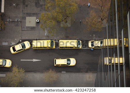 Melbourne, Australia-September 13, 2012. Aerial view down onto Yellow taxicabs on the streets of Melbourne, Victoria, Australia