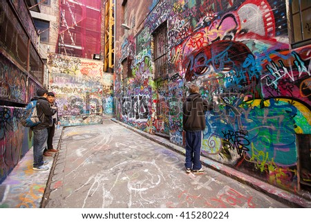 Melbourne, Australia-September 13, 2012. Graffiti artist in action in Hosier Lane, a much celebrated landmark mainly due to its sophisticated Urban art, in the centre of Melbourne, Victoria, australia