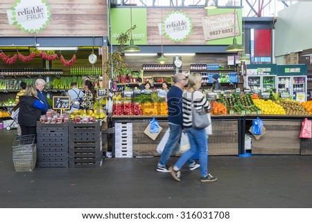 Melbourne, Australia - September 12, 2015: People doing grocery shopping in a market in Melbourne during daytime.  - stock photo