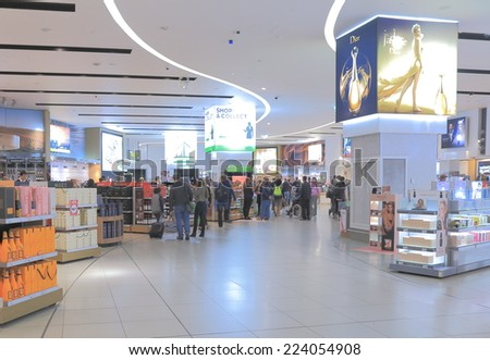 MELBOURNE AUSTRALIA - SEPTEMBER 13, 2014: Unidentified people shop at Melbourne Airport duty free shops - Melbourne Airport is the primary airport serving Melbourne and hub for Qantas airlines  - stock photo