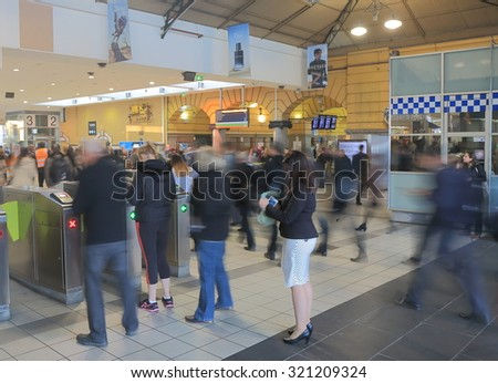 MELBOURNE AUSTRALIA - SEPTEMBER 24, 2015: Unidentified people travel at Flinders Street Station. The main station building was completed in 1909 and is a cultural icon to Melbourne  - stock photo