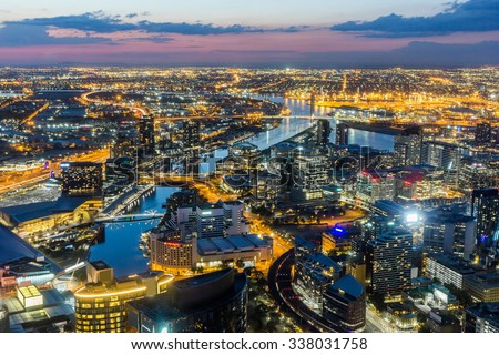 Melbourne City Aerial View Panorama Skyline Cityscape, Harbour, Seafarers Bridge, Bolte Bridge over Yarra River at Dusk Evening Sunset from Eureka Tower on South Bank, Victoria, Australia - stock photo