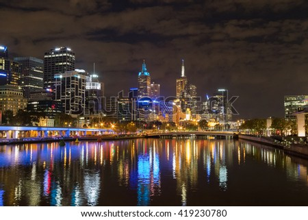 Melbourne city skyline at night with the view of Queens Bridge over the Yarra River in Victoria, Australia - stock photo