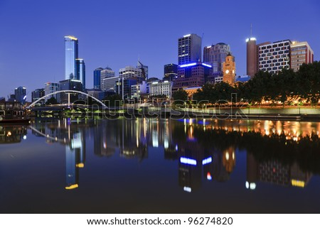 Melbourne city waterfront still reflection in Yarra river at sunrise - stock photo