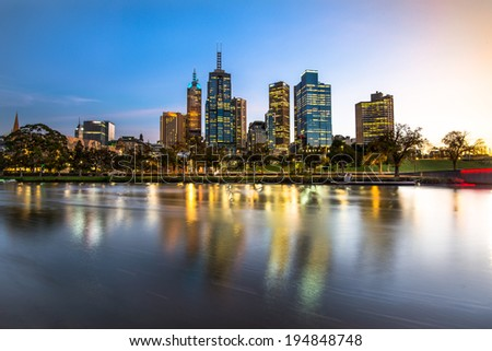 Melbourne city waterfront still reflection in Yarra river sunrise - stock photo