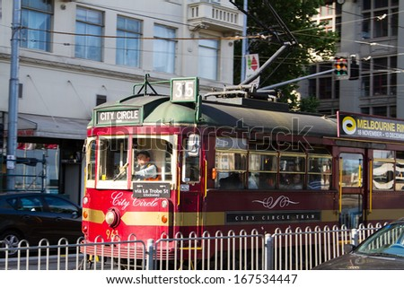MELBOURNE - DECEMBER 03: Famous vintage tourist trams on December 03, 2013 in Melbourne, Australia. Melbourne is the second most visited city in Australia