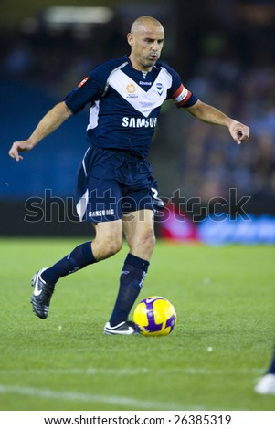 MELBOURNE - FEB 28: A-league Major Grand Final - Melbourne Victory defeat Adelaide United 1-0 on February 28, 2009 in Melbourne, Australia. Kevin Muscat controls the ball up field.