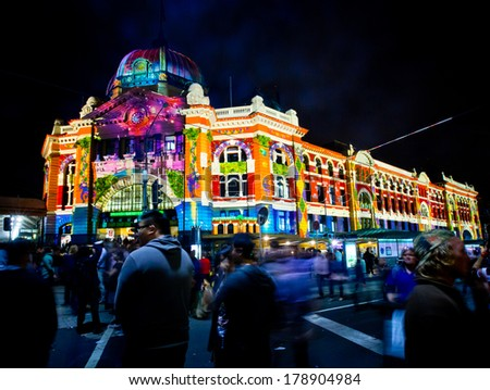 MELBOURNE - FEBRUARY 22: Flinders Street Station at Melbourne's White Night which attracted more than 500,000 visitors to the city centre - February 22, 2014 in Melbourne, Australia. - stock photo