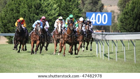 MELBOURNE - FEBRUARY 21: Horses entering the straight in the Ritchies Communities Benefits Plate, won by Quantum Fire at Yarra Glen on February 21, 2010 near Melbourne, Australia. - stock photo