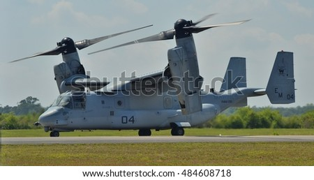 Melbourne, FL- March 21, 2015: A Marine Corps V-22 Osprey tilt-rotor helicopter-airplane prepares for take-off from an airfield in Melbourne. The Osprey belongs to Marine Corps Air Station New River.