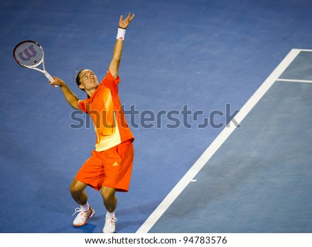 MELBOURNE - JANUARY 20: Alexandr Dolgopolov of the Ukraine in his third round loss to Bernard Tomic of Australia at the 2012 Australian Open on January 20, 2012 in Melbourne, Australia.