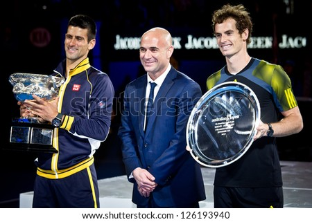 MELBOURNE - JANUARY 27: Andre Agassi poses with Novak Djolovic (L) of Serbia with the trophy for winning the 2013 Australian Open and Andy Murry  (R) on January27, 2013 in Melbourne, Australia. - stock photo