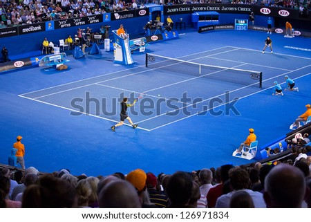 MELBOURNE - JANUARY 27: Andy Murray of Scotland (L) in his loss to Novak Djokovic of Serbia in the 2013 Australian Open Championship Final on January 27, 2013 in Melbourne, Australia. - stock photo