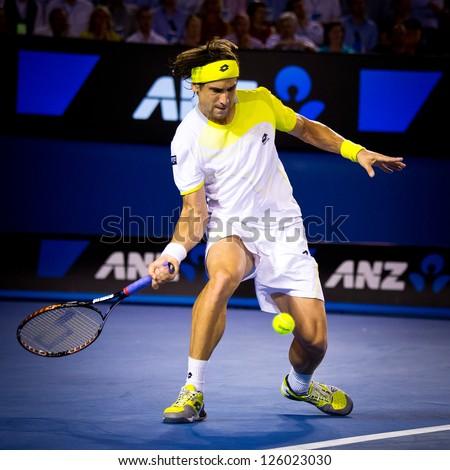 MELBOURNE - JANUARY 24: David Ferrer of Spain in his quarter final loss to Novak Djokovic of Serbia at the 2013 Australian Open on January 24, 2013 in Melbourne, Australia. - stock photo