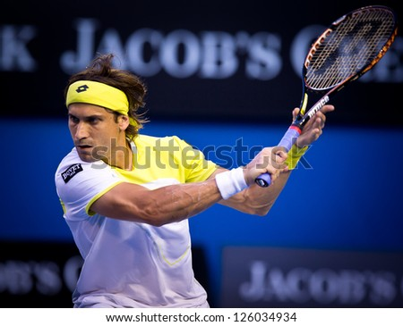 MELBOURNE - JANUARY 24: David Ferrer of Spain in his quarter final loss to Novak Djokovic of Serbia at the 2013 Australian Open on January 24, 2013 in Melbourne, Australia. - stock photo